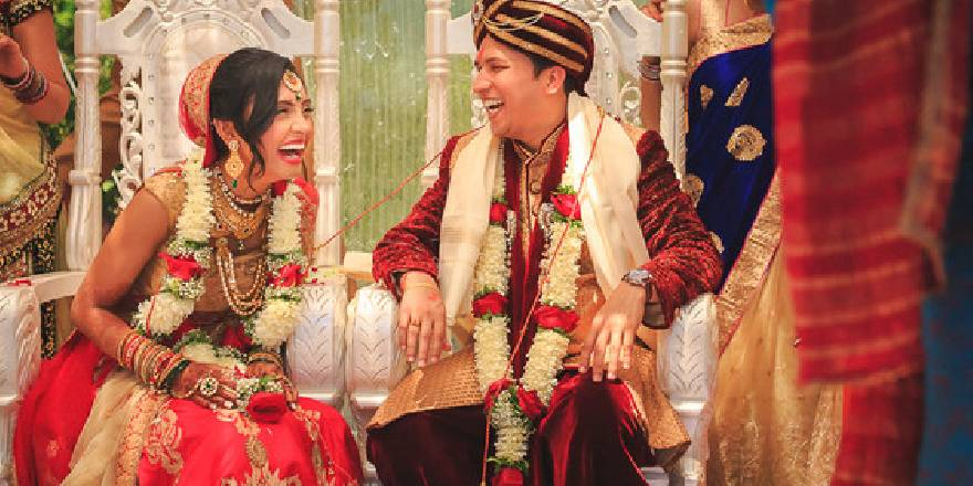 A Candid Photography of a Beautiful Bride and Groom Laughing with each other on their wedding