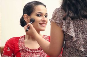 Image Of A Bride Taken Face Makeup By a Professional Wedding Makeup Artist