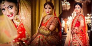 Stunning Indian Bride Dressed In Bright Red Colored Lehanga With Full Makeup And Wearing Heavy Jewellry.