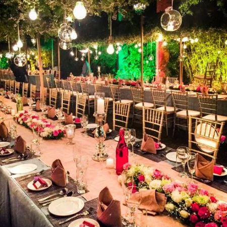 Wedding Dining Area, arch decorated with composition flowers and greenery, candles in the banquet hall.
