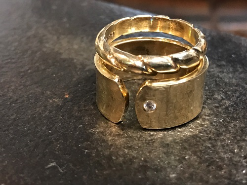 Steel Fabricated Wedding Ring Showcased On The Table.